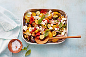 Mediterranean baked potato and vegetable salad with feta