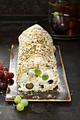 Meringue roll with grape cream