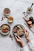 Porridge with plums, hazelnuts, chia, tahini and peanut butter