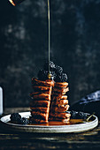 Pumpkin pancakes with blackberries and maple syrup