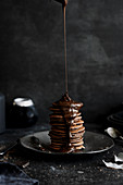 Chocolate pancakes topped with melted chocolate