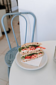 Sandwich with mozzarella, tomatoes and arugula