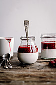 Panna cotta in a jar with raspberry mousse