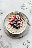 Winter porridge with red currants and blackberries