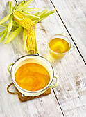Corn tea in a pot and glass