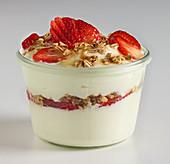 Strawberry yoghurt with granola and honey