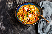 Thai style fish curry with rice noodles and prawns
