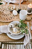 An Easter place setting in natural colours