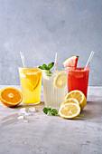 Homemade lemonade with melon, lemon and orange