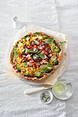 Vegetarian rainbow pizza with a spelt base