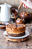 Snickers cheesecake with chocolate icing