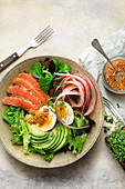 Salad bowl with salmon and avocado