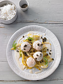 Salmon trout dumplings with lime butter and capers
