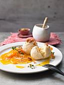 Vanilla quark dumplings with mandarin compote