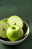 Granny Smith apples in the bowl