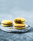 Yellow macaroons with date chocolate cream