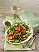 Chicken skewers with rocket, peach and avocado