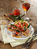 Saltimbocca skewers with apricot and raspberry sauce
