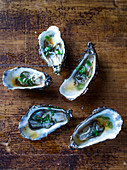 Steamed oysters with soy sauce and spring onions