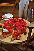 Strawberry sponge cake with pistachio nuts