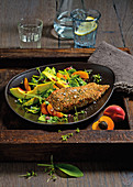 Salmon fillet in a sesame seed crust with a spinach and apricot salad