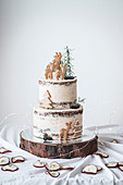 A two-tier baked apple cake with cinnamon buttercream and Christmas decorations