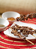 Chinese lamb skewers with sambal oelek, soy sauce and chilli flakes
