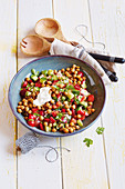 Warm chickpea salad with peppers and Greek yoghurt