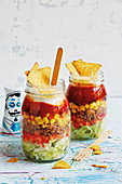 Layered taco salads in glasses (football evening)