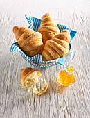 Fresh butter croissants with marmalade