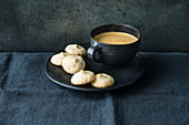 Gluten-free amaretti with a cup of coffee