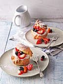 Stuffed cream puff profiteroles with fresh berries