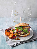 oat vegetable burger served on a focaccia bun with vegetable chips