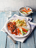 Beef beer goulash from the calf with herb spaetzle and vegetables