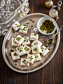 Marzipan cubes with pistachios