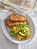 Veal schnitzel with potato salad with aocado