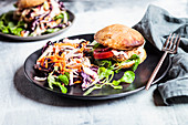 Gluten-free salmon burger with cole slaw
