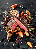 A check eye roll with roasted vegetables made in a Beefer