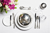 A place setting with a cloche