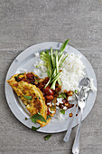 Spicy omelette on rice with Thai basil