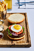 A beef burger with a quail's egg