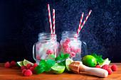 Glasses of homemade raspberry and lime lemonade
