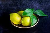 Lemons in a metal dish