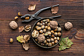 Forest nut harvest on old wooden table