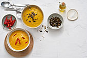 Cauliflower and carrot soup and curry-sweet potato soup