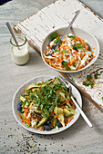 Carrot and fennel salad, and a Good Vibes salad with fruit and vegetables