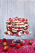 Pancake cake with plant-based cream and strawberries (vegan)