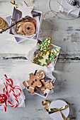 Gingerbread people and butter biscuits in gift boxes