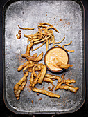 Crispy ears and tripe with harissa mayonnaise