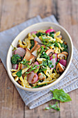 Spätzle (Swabian egg noodles) with mushrooms, radishes and spinach